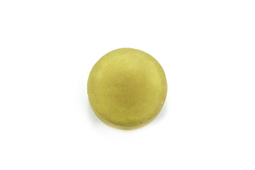 gold shiny soap on white background