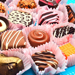 assortment of different delicious chocolate sweets background