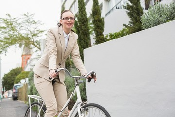 Young businesswoman riding her bike