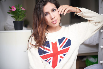 brunette woman with wet hair and colors of the British flag