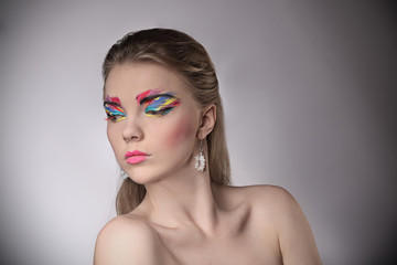 beautiful woman with fashion hairstyle and glamour makeup