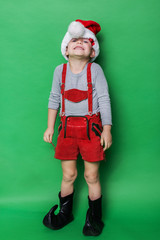 Little child with Christmas dwarf costume