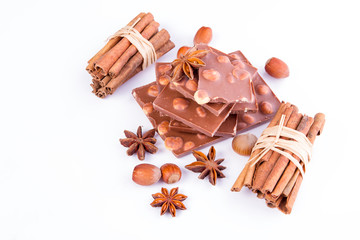 Plate of milk chocolate with nuts with additives anise, cinnamon