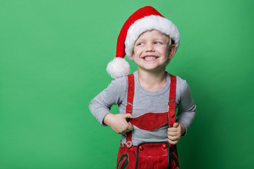 Beautiful little boy dressed like Christmas elf with big smile