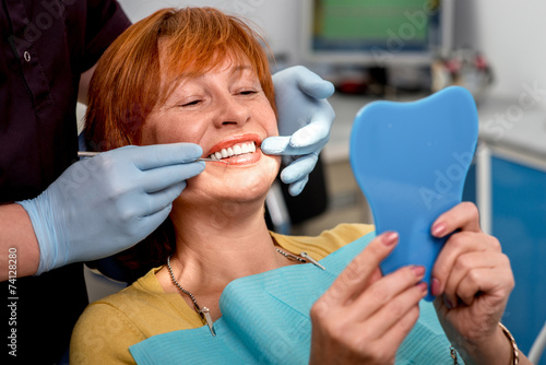 Fototapeta Senior woman in the dental office.