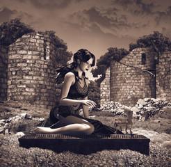 giovane donna seduta su tomba