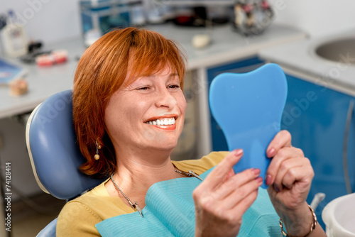 Senior woman in the dental office. - 74128414