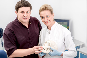 Dentist with assistant in the dental office