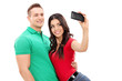 Girl taking a selfie with her boyfriend with a cell phone