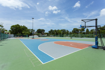 Outdoor basketball court in Thailand on a sunny day