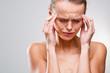 Beautiful woman suffering from acute headache