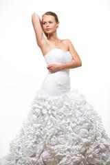 Gorgeous bride in her wedding dress on white background