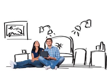 Composite image of young couple sitting on floor with tablet