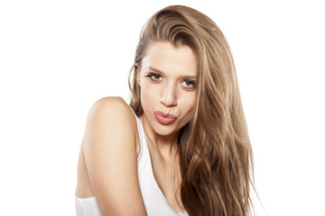 happy beautiful young woman on a white background