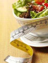 Salad in a Bowl with a Tape Measure