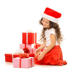 Girl with Christmas gift boxes. Isolated on white background
