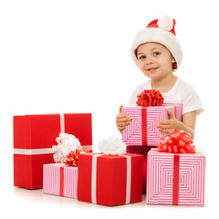 Boy with Christmas gift boxes. Isolated on white background