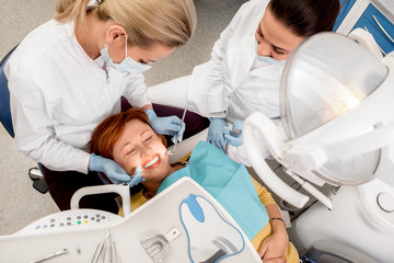 Senior woman on the dental operation.