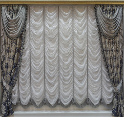 Curtains with lambrequins and white curtains with assemblies
