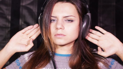 Girl with headphones on sofa relax