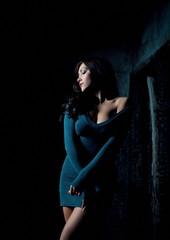 Dark blue short dress fashion model with huge breasts
