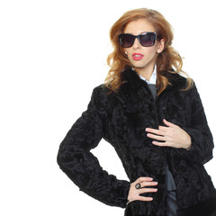 beautiful girl in a fur coat. White background.