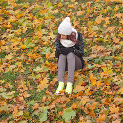 The sad hipster girl with autumn depression.