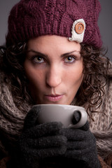 woman with a mugful of a hot drink