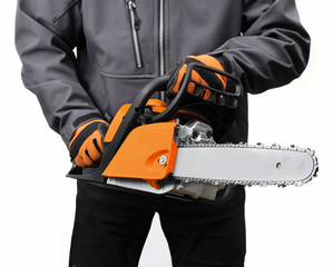 Chain saw in male workers hands