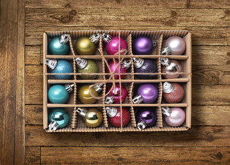 Colorful Xmas balls on old wood background