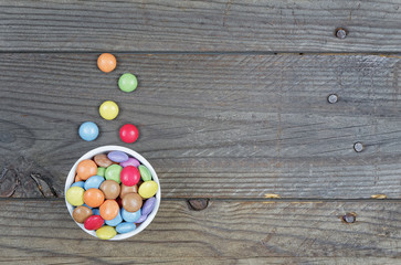 multicolor candy on wood background