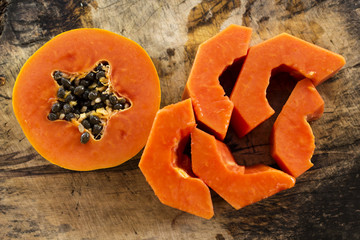 Sliced of fresh sweet papaya on wooden background