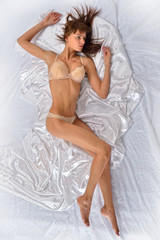 beautiful naked woman in underwear in the bed.