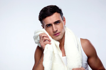 Handsome man drying his face with towel