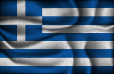 crumpled flag of Greece on a light background