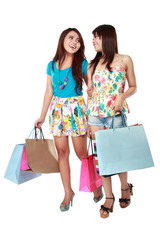 happy two shopping girl holding bags