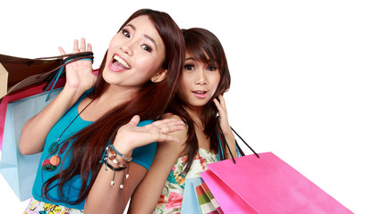 Close up two beautiful woman friend with many shopping bags