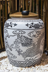 White jar with blue dragon painting