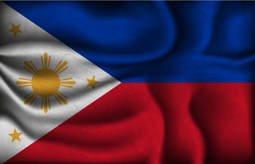 crumpled flag of Philippines on a light background