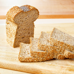Rye bread slices on wooden table