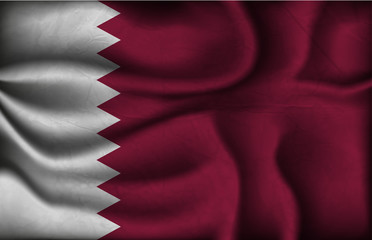 crumpled flag of Qatar on a light background