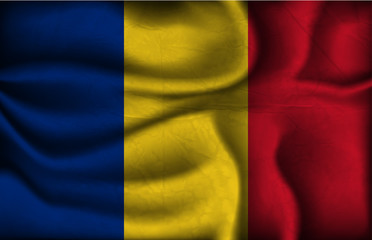 crumpled flag of Romania on a light background