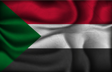 crumpled flag of Sudan on a light background