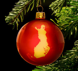 Red bauble with the golden shape of Finland