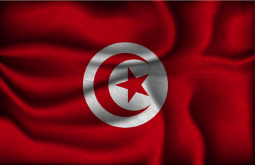crumpled flag of Tunisia on a light background