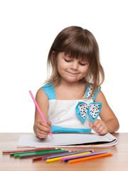 Preschool girl at the desk