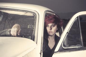 Woman inside an old car