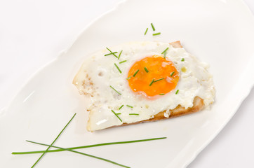 fried eggs with salt and chives