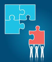 Teamwork concept - people building puzzle