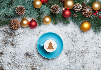 Cappuccino with christmas tree shape and pine branch on artifici